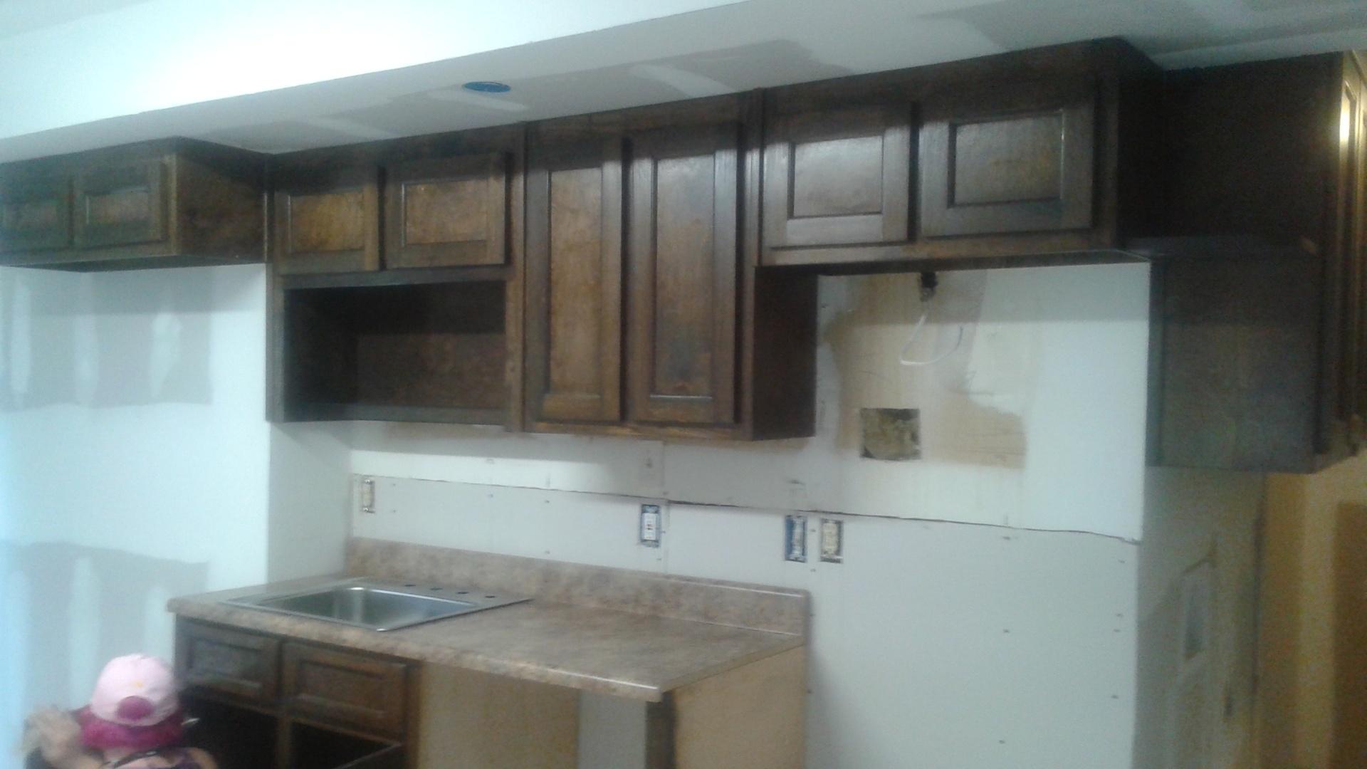 small dark walnut kitchen