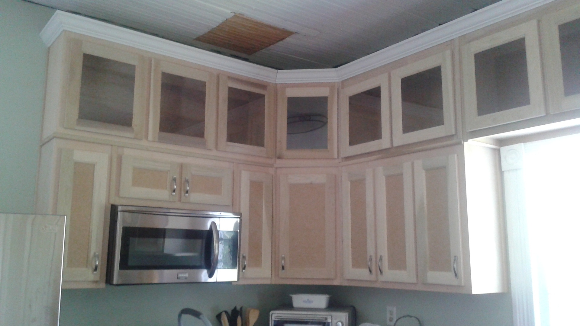 "54"" cabinets with glass doors at top"