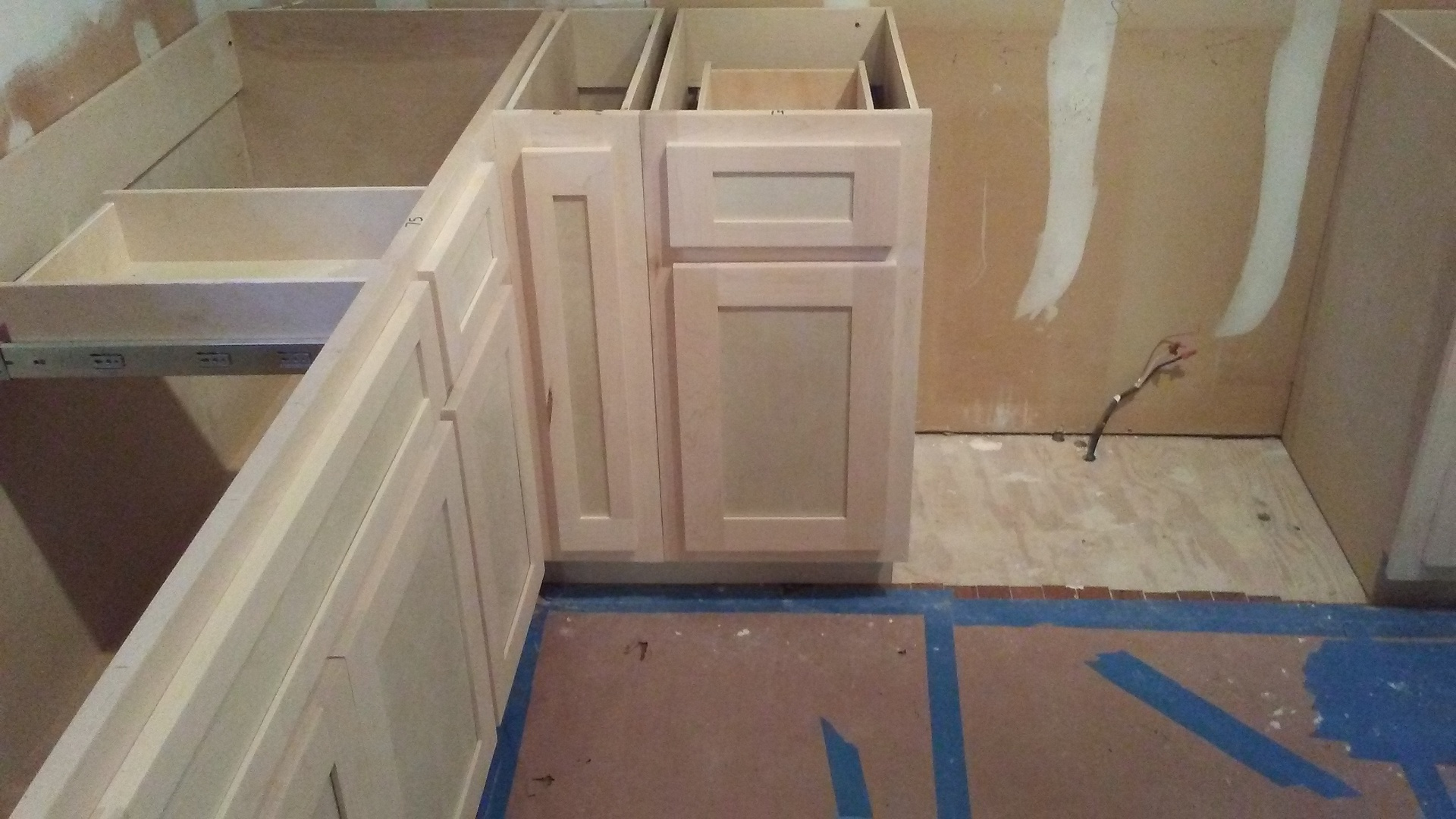 cookie sheet cabinet by oven